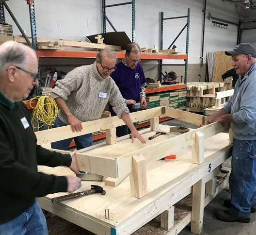 volunteers building a bed at Building Beds 4 Kids