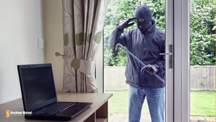 theif breaking into home to steal computer