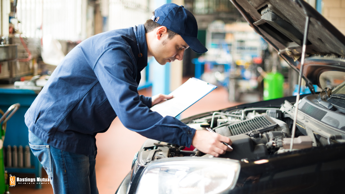 auto mechanic repairing car engine