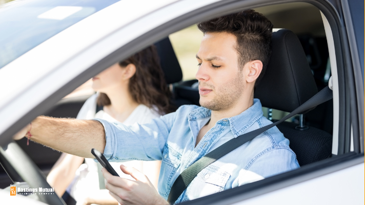young man texting while driving