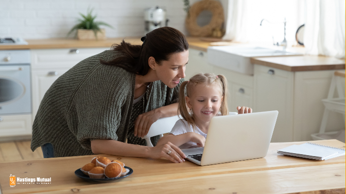 young mother with daughter looking at websites online