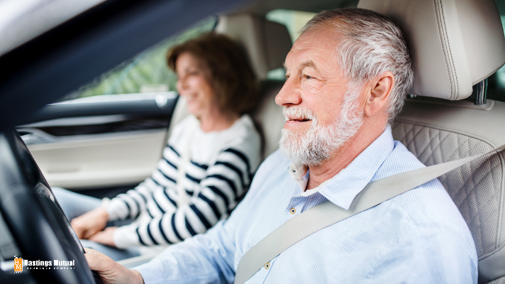 elderly couple driving a car in Michigan