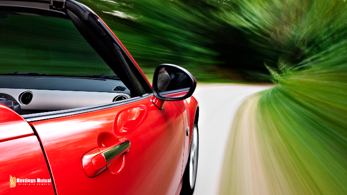 red color sports car driving fast