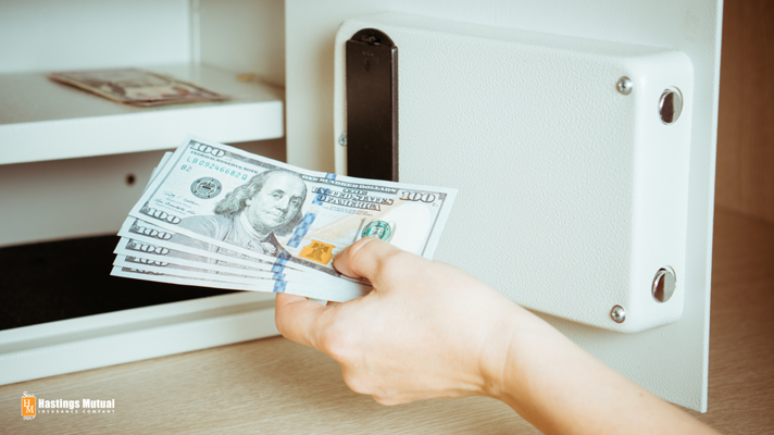 business or home owner putting money in safe