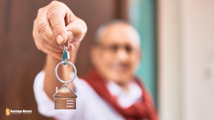 Elderly person with keys to new house