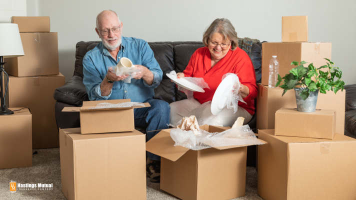 elderly home owners packing to move to new home